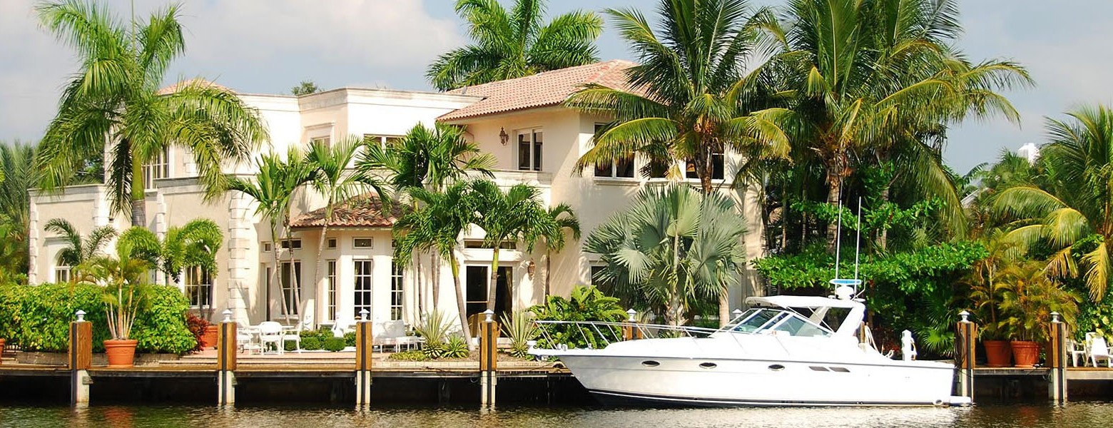 luxury waterfront property with boat